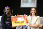 Mrs Hans, Librarian, with Sandra Agard, Storyteller, and the winner's certificate